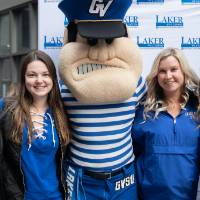 Louie the Laker poses with group of alumni